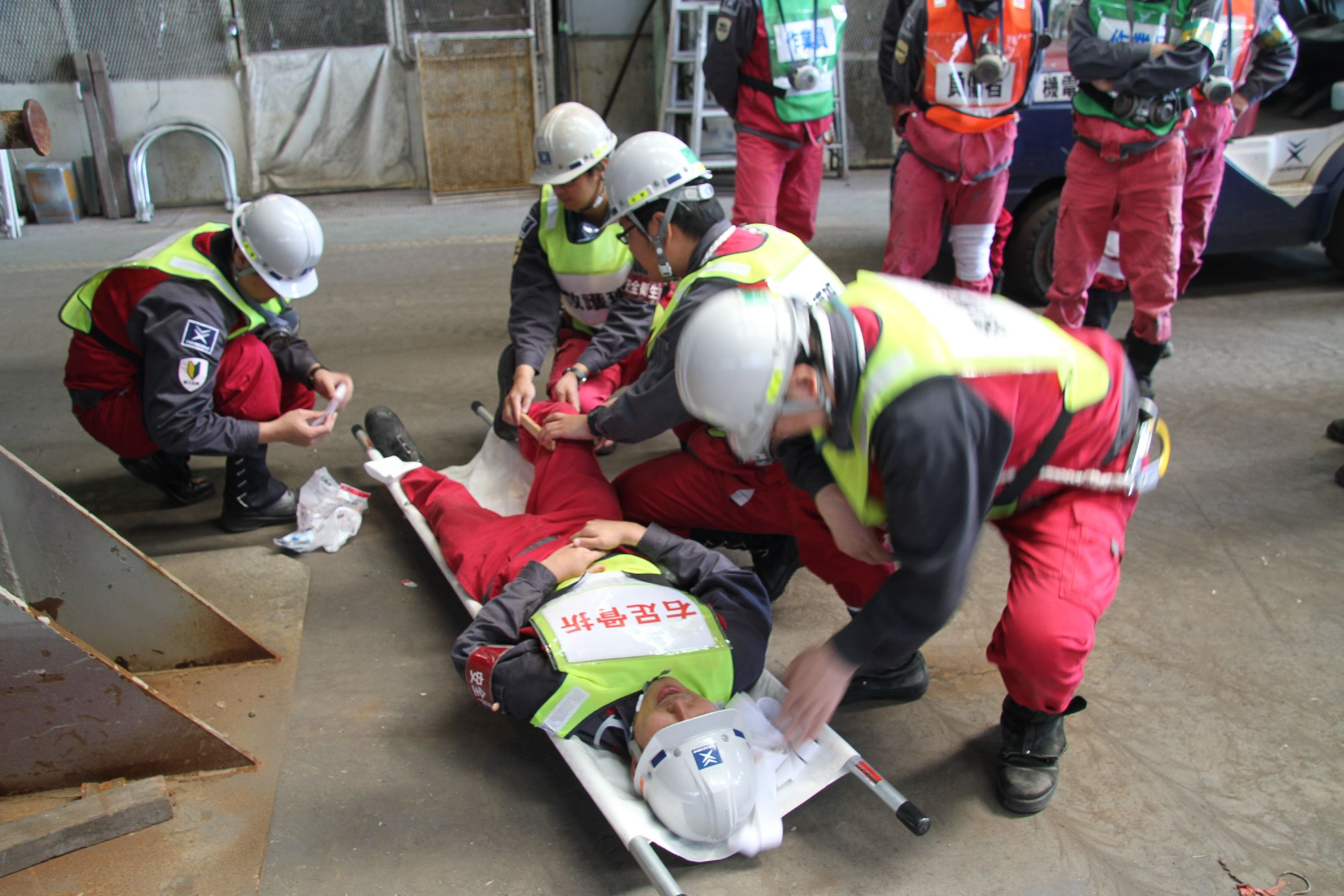 Carrying a person in need of help with a stretcher